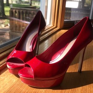 Red high heeled shoes.
